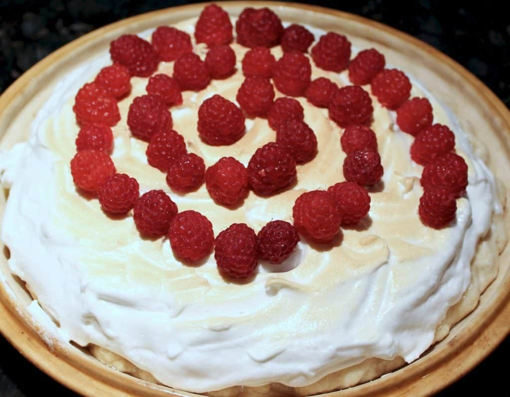 Top Lemon Meringue Pie with Raspberries for fun and extra flavor!