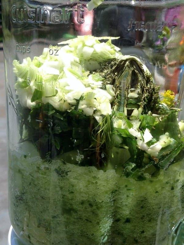 vegetables partially blended in a blender.