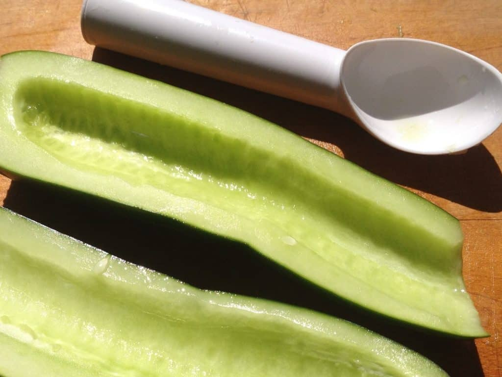 one cucumber cut in half and seeded.