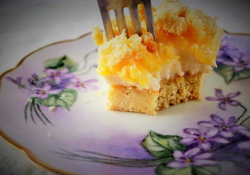 Lemon Cheesecake Delight is a delicious make ahead dessert. Fresh, lemon curd topping, No Bake-Cheesecake filling, with a Lemon cookie crust. Perfect for potlucks, holidays or family treats anytime.