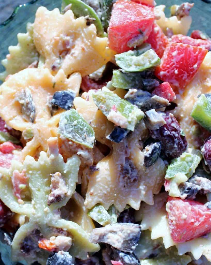 Pasta salad full of fresh sweet peppers and tomatoes