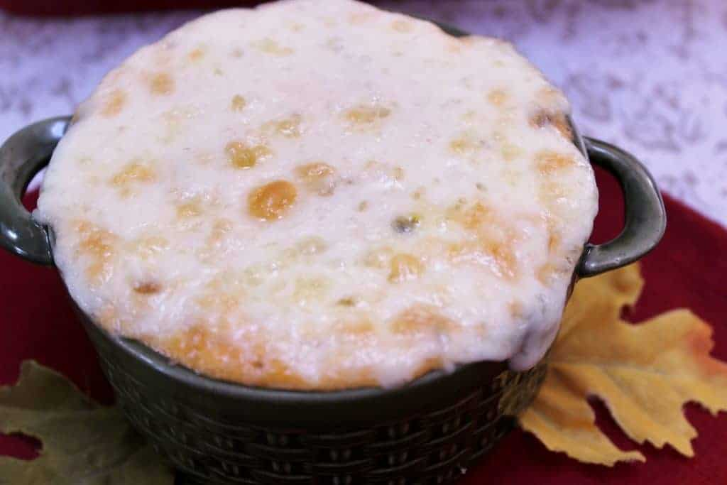 A delicious Roasted Corn dip at your next fall party event! Bursting with cheesy, bacony goodness this warm fragrant dip will add a pretty, tasty appetizer to your party menu, game or movie night!