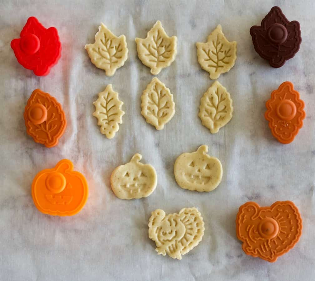 pie dough cut outs and stamps with the raw dough shapes they create
