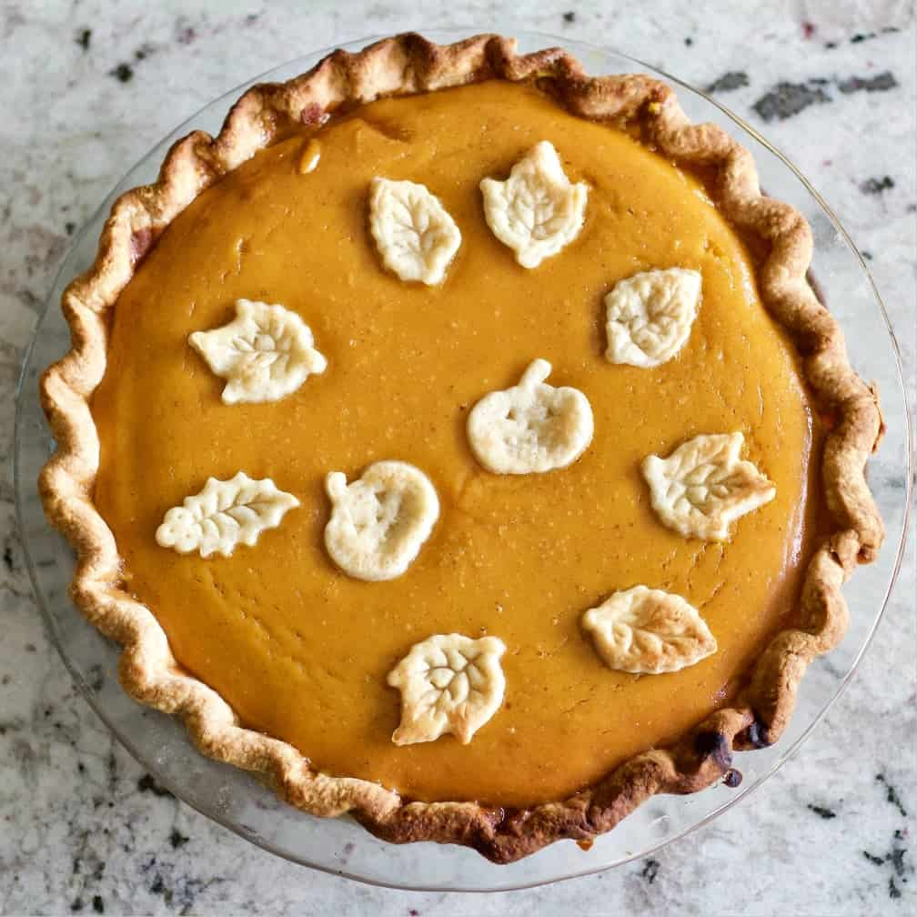 Pumpkin Pie with pumpkin and leaf dough toppers.