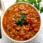 Crock Pot Pepper Soup with Orzo and rice and garnished with a bit of fresh cilantro