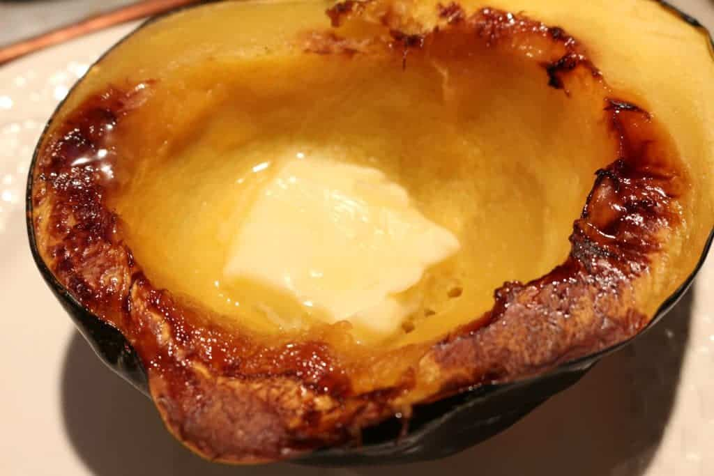 Easy Baked Acorn Squash so delicious with butter! http://HomemadeFoodjunkie.com