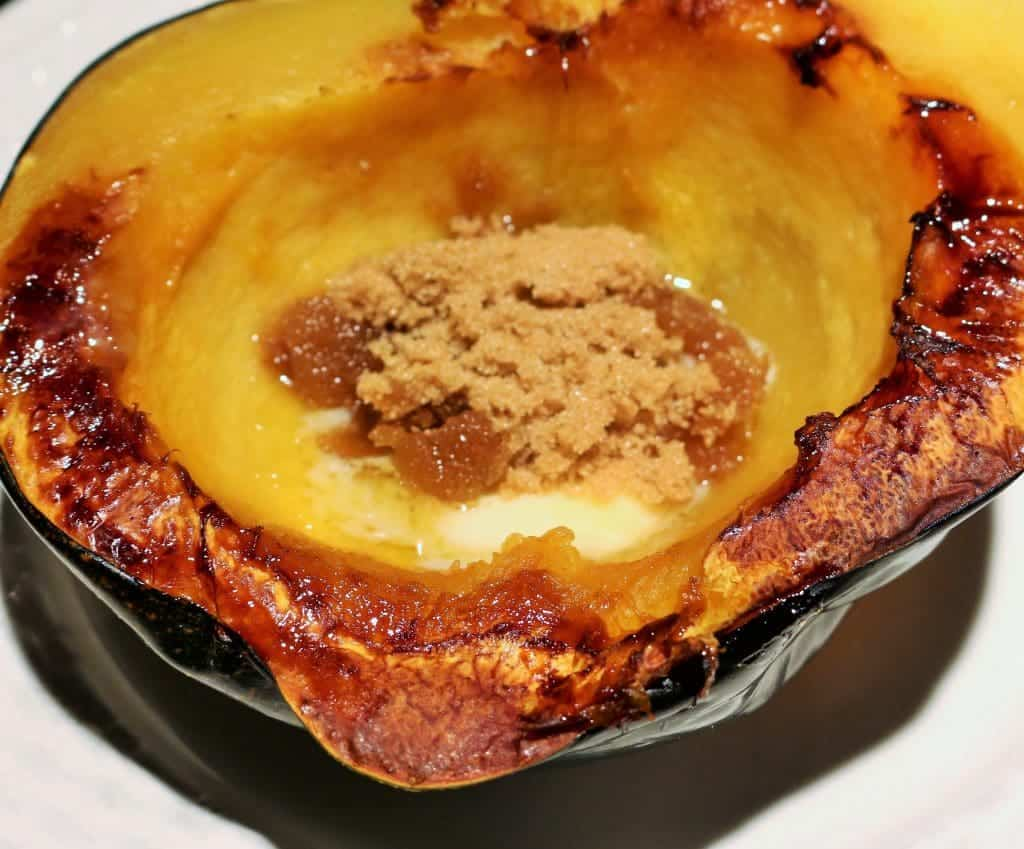Easy Baked Acorn Squash add a dash of brown sugar or maple syrup for extra yumminess! http://homemadeFoodJunkie.com