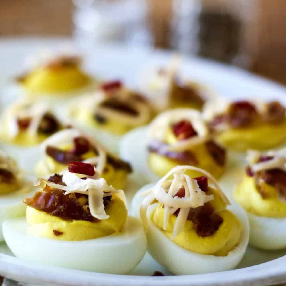 Deviled Eggs with Bacon,peppers and dates http://homemadeFoodjunkie.com