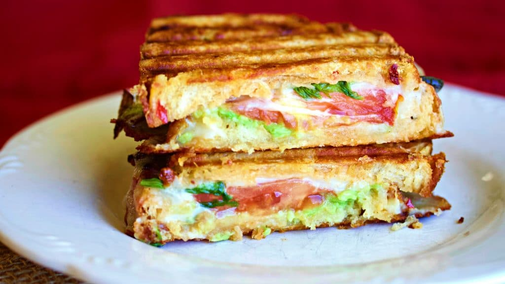 Delicious warm, and melty Southwest toasted cheese sandwich is a flavorful combination of your favorite artisan bread filled with healthy avocados, a delicious homemade Southwest sauce, peppers and bacon melted together with your favorite smoked cheese.