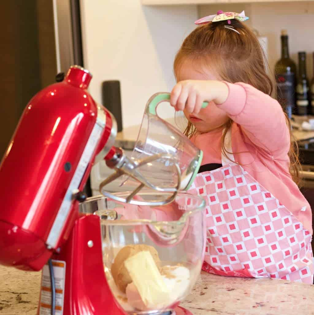 Three year old Ellie Adding ingredients into the kitchen aid work bowl