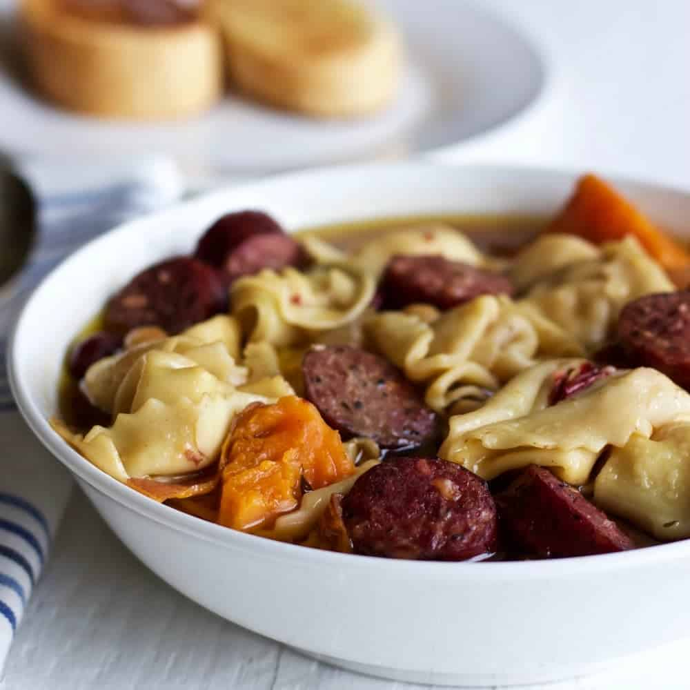 Crock pot tortellini sausage soup. An easy, high fiber meal! http://homemadeFoodJunkie.com
