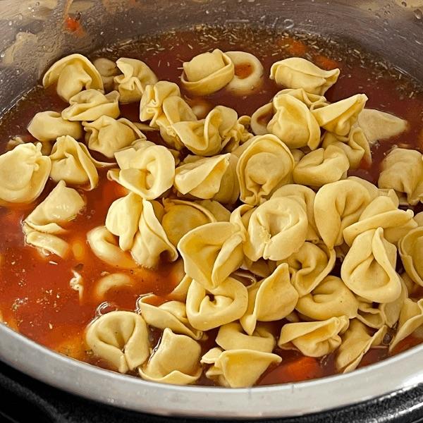 Adding Tortellini To Tortellini Sausage Soup