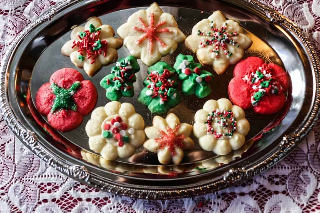 Spritz Cookie recipe with colored doughs and sprinkles.