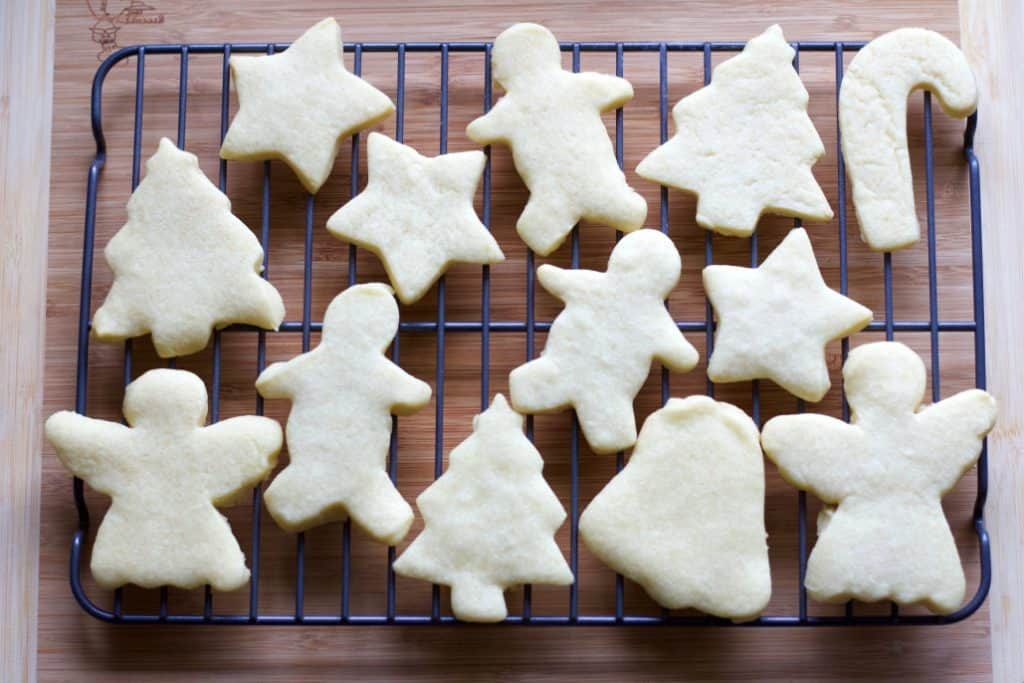 Shortbread cookies in Christmas shapes on a cooling rack