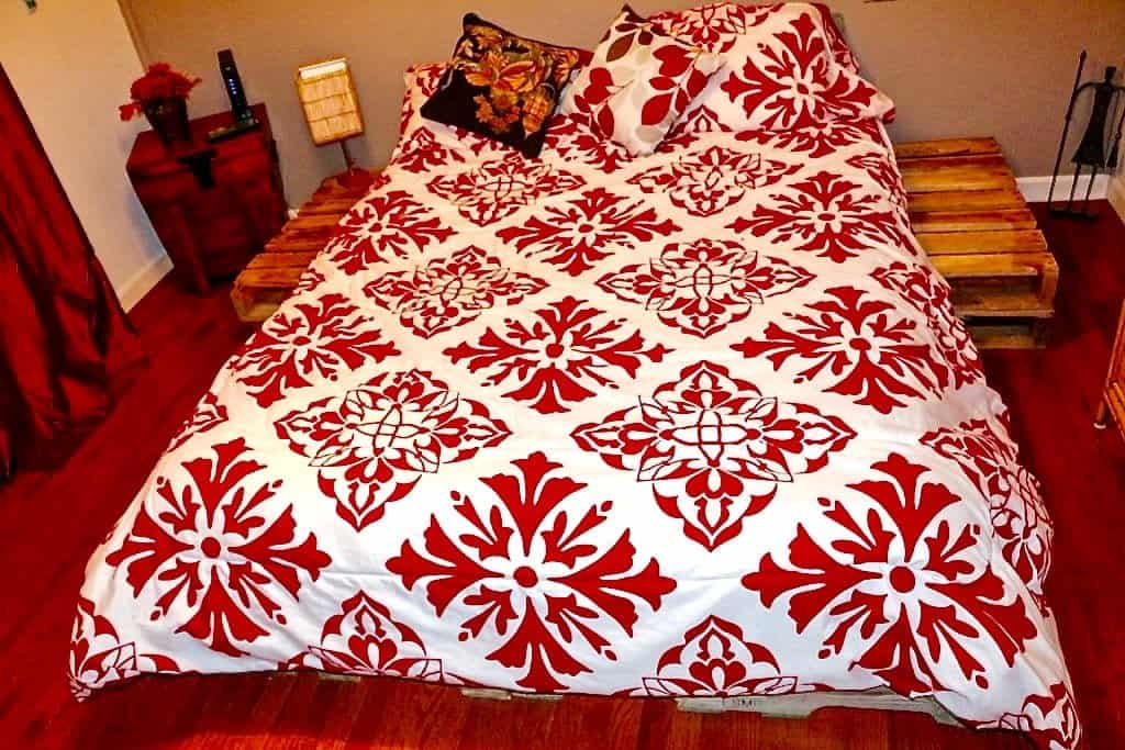 DIY Pallet Bed arranged so you even have attached night stands! homemadeFoodJunkie.com