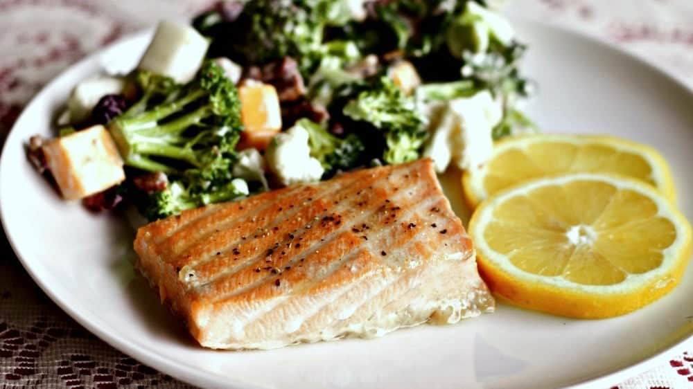 Easy baked salmon with a brown sugar marinade is a perfect choice for a delicious, low carb, dairy -free, gluten-free meal choice. Chock full of good for you lean protein and healthy fat with a yummy marinade! http://HomemadeFoodJunkie.com