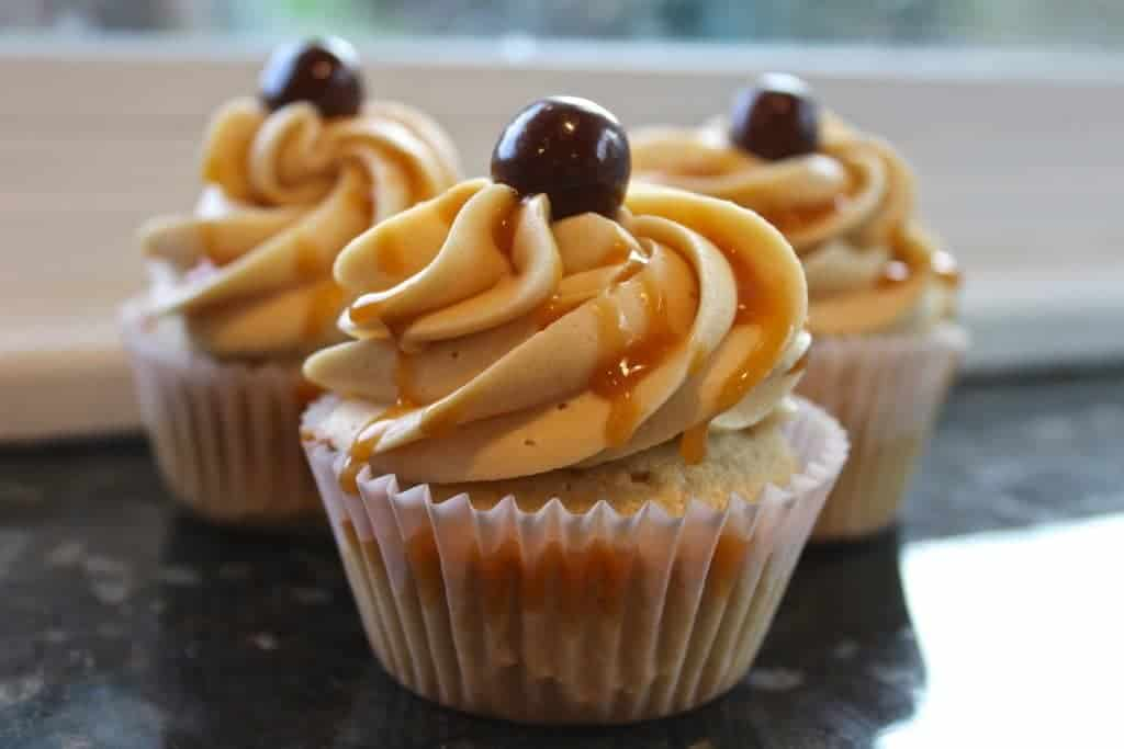 Coffee Cupcakes Salted Caramel Buttercream Frosting Decadent Coffee Cupcakes Topped And Drizzled With A Salted Caramel Buttercream Frosting And Garnished With A Chocolate Covered Espresso Bean.