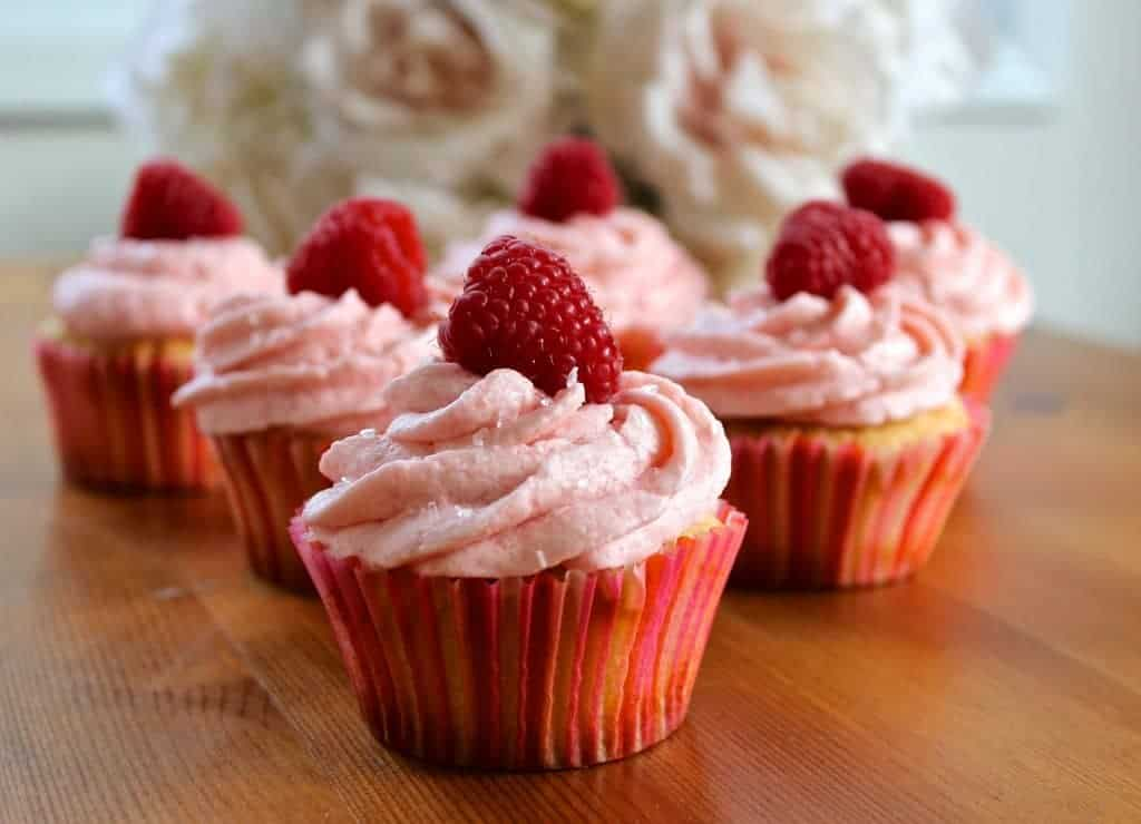 Delectable champagne cupcakes with raspberry buttercream frosting.