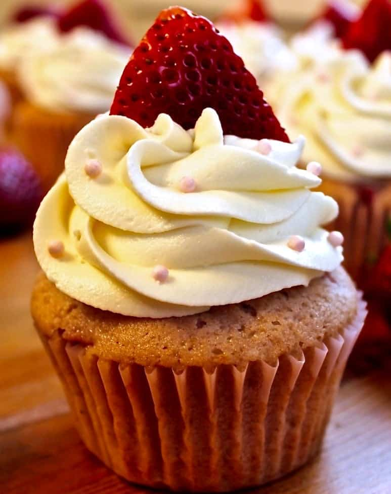 Fresh Strawberry Cupcakes with fresh strawberries baked right in! By http://homemadeFoodJunkie.com