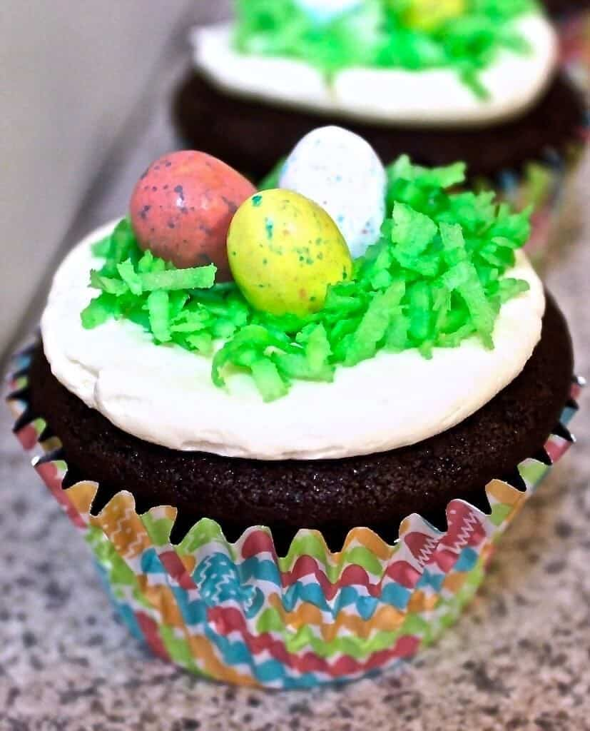 Easter egg hunt cupcakes with a cadbury egg baked into the center of the cupcake