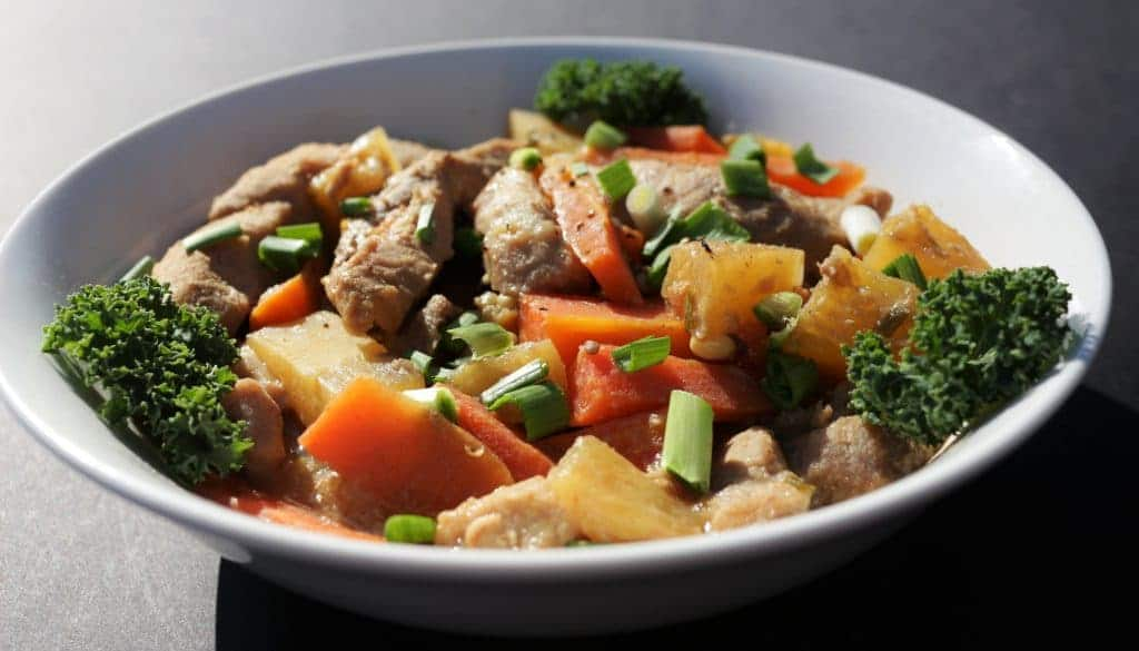 Crock Pot Asian Pineapple Pork with fresh garlic, ginger and turmeric makes a flavorful healthy meal.