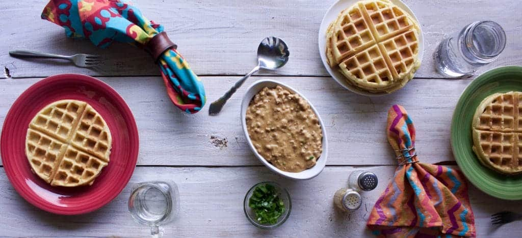 Savory Waffles and Gravy A hearty meal of waffles and sausage gravy http://HomemadeFoodJunkie.com