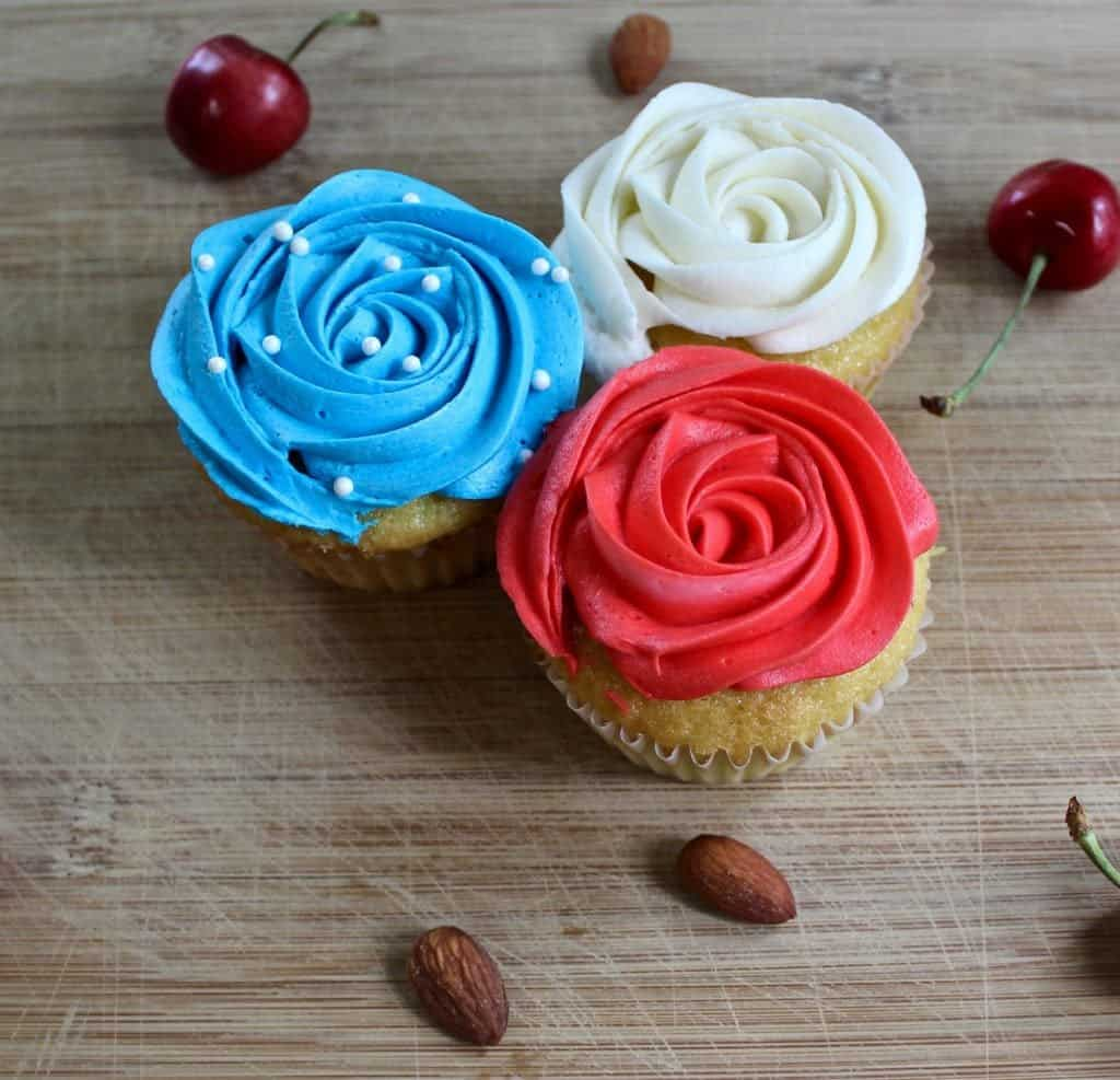 Festive Cherry Almond Cupcakes. A delicious almond cupcake topped with a silky cherry buttercream frosting!