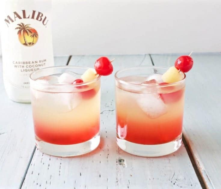 "Delicious and refreshing Malibu Sunset Cocktail. If you are looking for an easy to make mixed drinks recipe, look no further! This lovely drink offers a beautiful blend of coconut rum, pineapple, and sweet grenadine. Our Texas readers call it a ""Panty Dropper"".   Some claim this perky beauty is a ""Malibu Barbie"". No matter the name, this is a popular party drink you will love! #mixeddrinks #cocktail #malibusunset #malibubarbie #pantydropper"