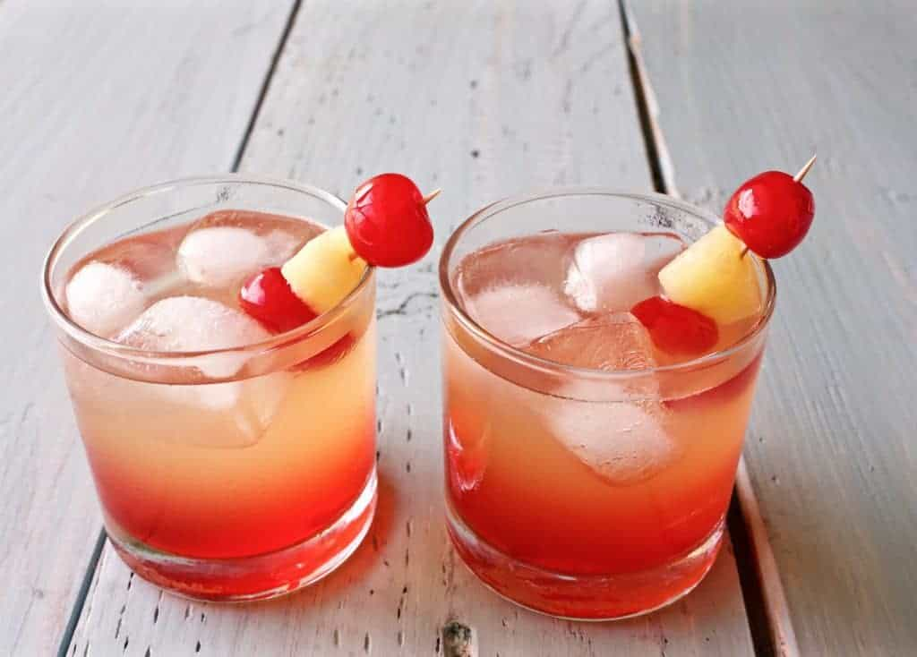 Malibu Sunset Cocktail a Delicious and refreshing cocktail. This easy to make, lovely drink offers a beautiful blend of coconut rum, pineapple, and sweet grenadine.