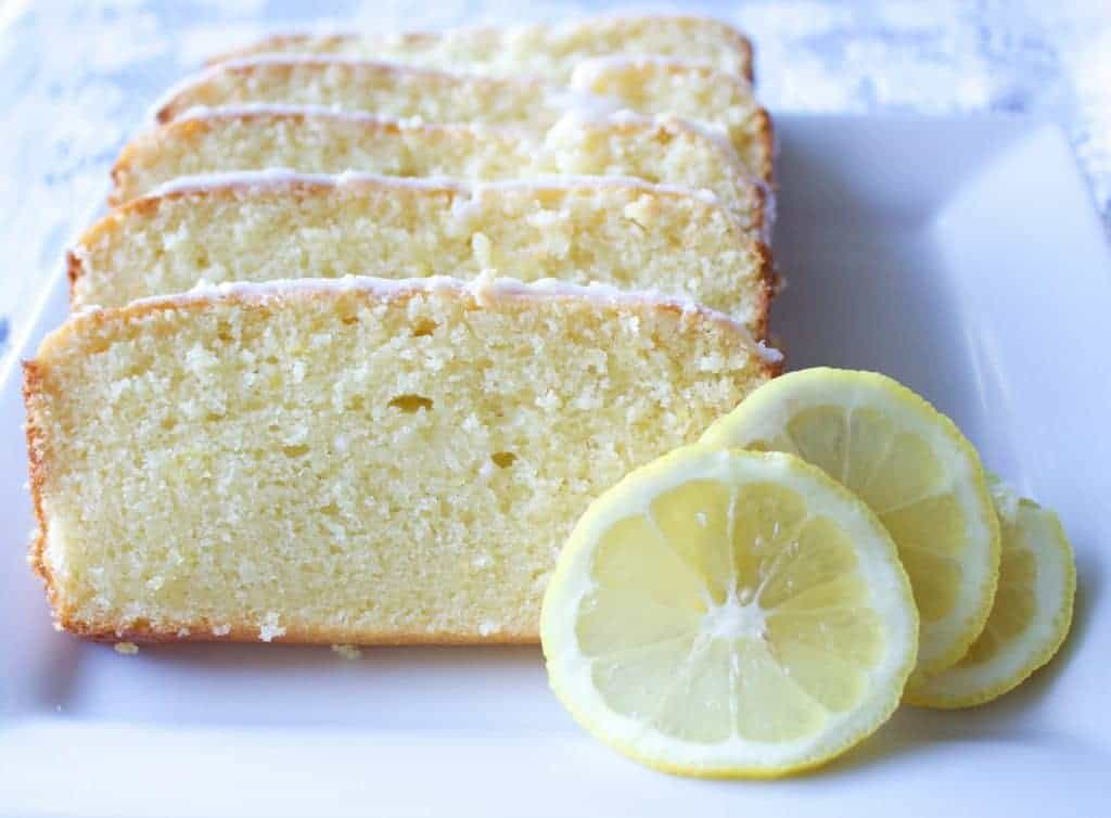 Iced Lemon Loaf is a Light and sweet lemon loaf dripping with a lemony iced glaze. This sweet loaf goes perfect with party platters and a cup of coffee!