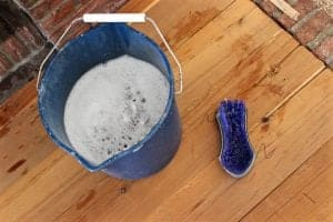 Use a bucket of warm water with a few drops of dish soap (we used Dawn) to properly scrub and clean fireplace