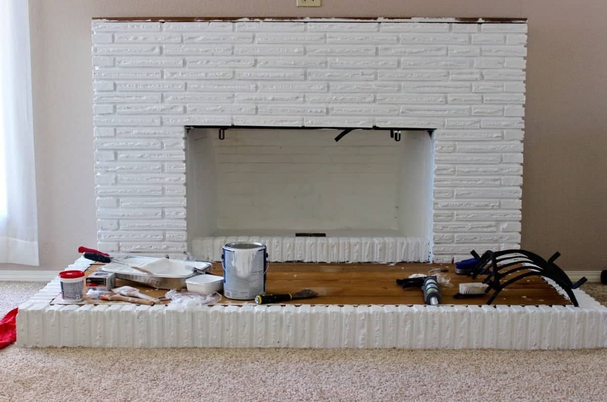 This week we are painting the old red brick white! our fireplace overhaul is moving ahead and it looks awesome!