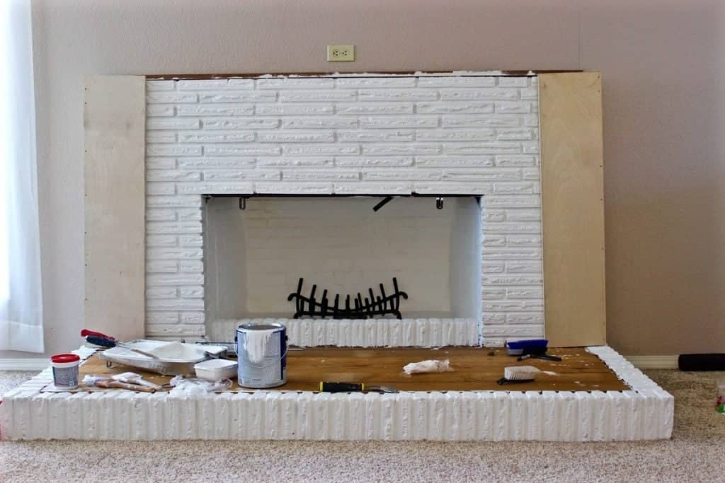 You can see the sides of the mantle that we are now in the process of building! Also that black wood holder was the nasty old one that was rusted in the original fireplace. We took it out and brushed it with a wire brush and sprayed it with Rust - Oleum! love it!