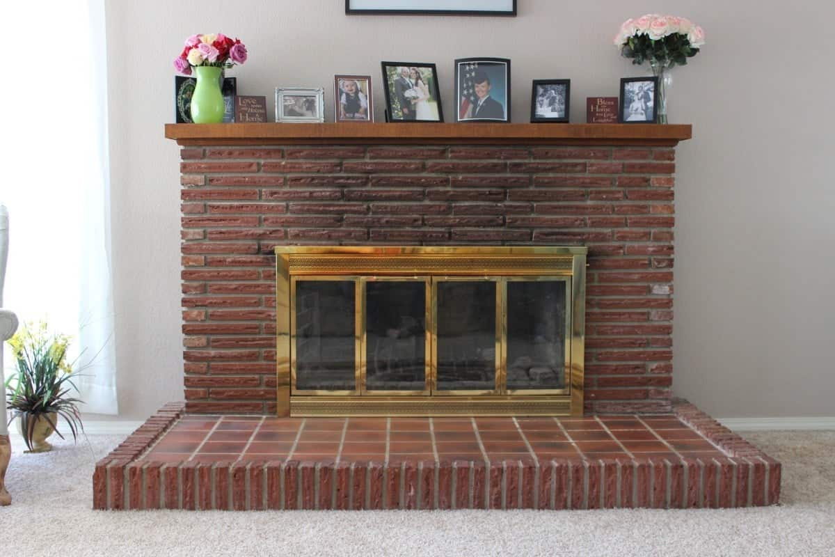 DIY Fireplace Overhaul Reveal See how we transformed our ugly old fireplace into a gorgeous focal point for our home! #DIY #diy #fireplace #brickfireplace #paintingbrickfireplace #fireplaceremodel #fireplaceoverhaul #brick #fireplace #paint