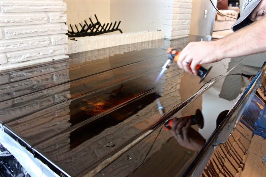 Applying heat to the epoxy layer