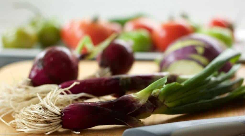 Small red onions. homegrown produce and marinara sauce for Chicken Noodle Minestrone