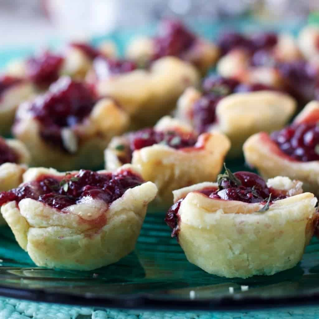 Cranberry Raspberry Brie Bites are a quick, easy appetizer. Pretty heathy and full of cranberry raspberry flavor!