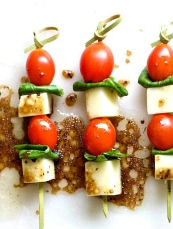 caprese appetizers on a party tray