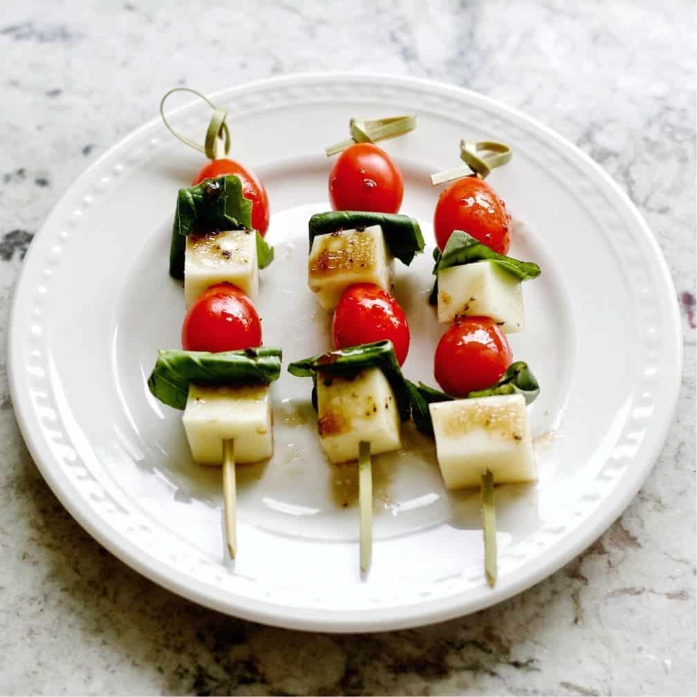 Caprese salad bites on a plate.
