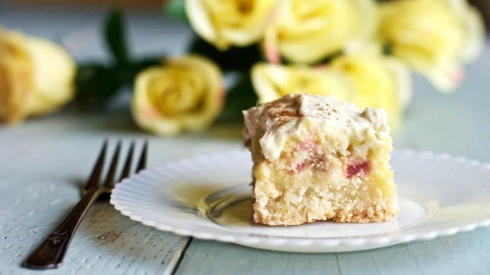 Creamy Rhubarb Shortbread Squares Rhubarb lovers this recipe is for you! That tangy rhubarb flavor makes Creamy Rhubarb Shortbread Squares Irresistible! Our rhubarb is ripening now. I froze 2 gallon ziplock bags of chopped rhubarb yesterday. The rest is in this delicious dessert. http://homemadeFoodjunkie.com