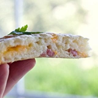 Ham and Cheese Scone in a hand