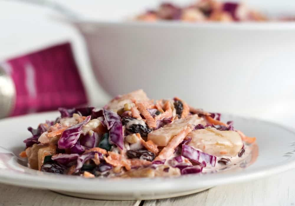 Red Cabbage Carrot Salad a beauty of a summer salad! Red Cabbage Carrot Salad is so yummy with all these flavors and textures and it's healthy! Enjoy the High-Fiber, Vegetarian, Dairy-Free, Gluten-Free seasonal side dish. It's perfect for the dinner table, lunchbox or picnic! http://HomemadeFoodJunkie.com