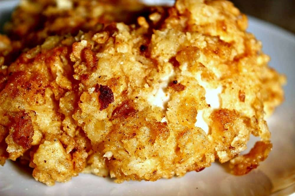 The Best Buttermilk Fried Chicken with a delicious cajun twist, fried in a creamy buttermilk batter.