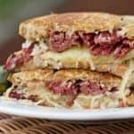 Reuben Sandwich is a Favorite American Sandwich. Piquant combination of Swiss Cheese, corned beef, sauerkrau