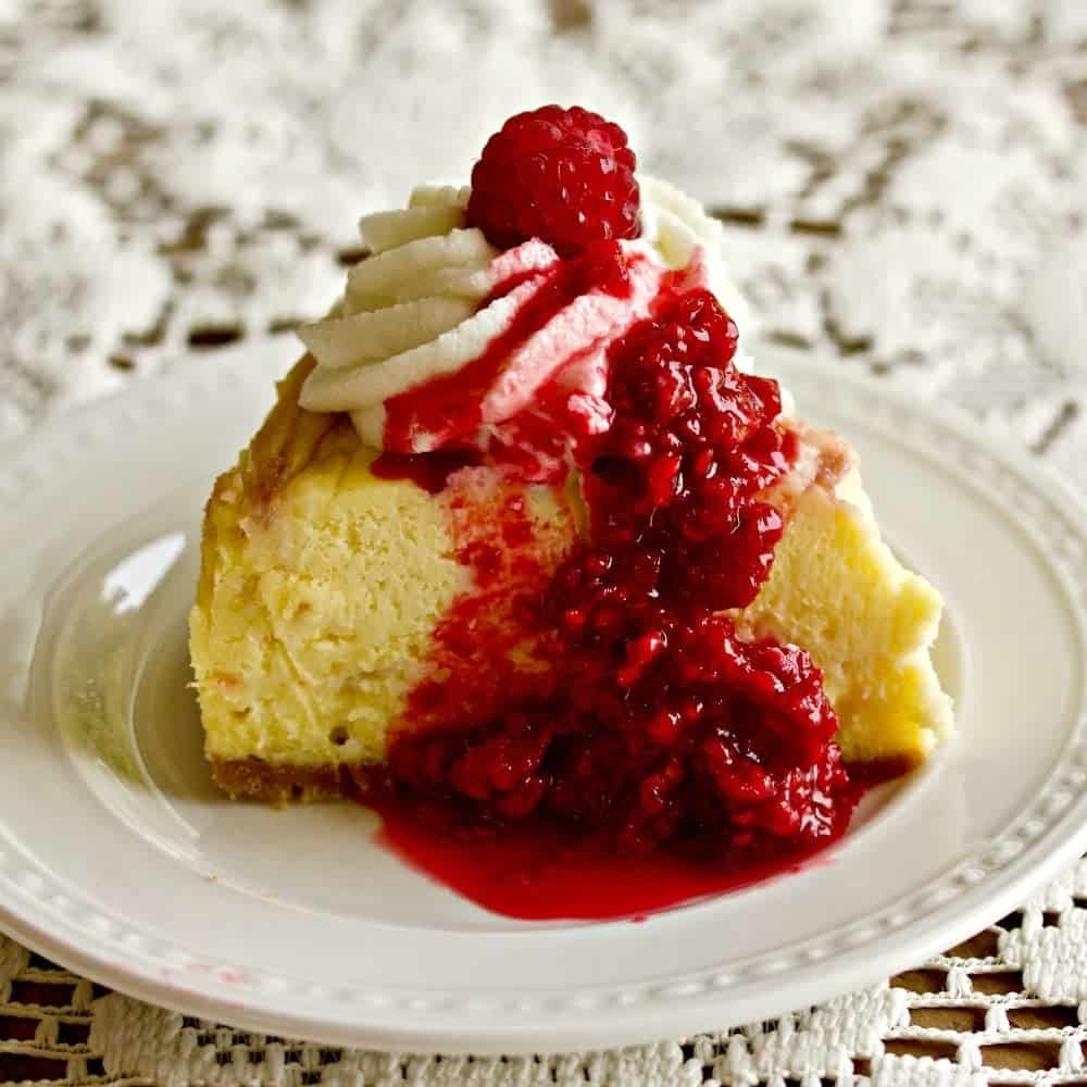 Instant Pot White Chocolate Raspberry Swirl Cheesecake with roasted raspberries
