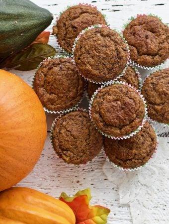 Sourdough pumpkin muffins next to winter squash