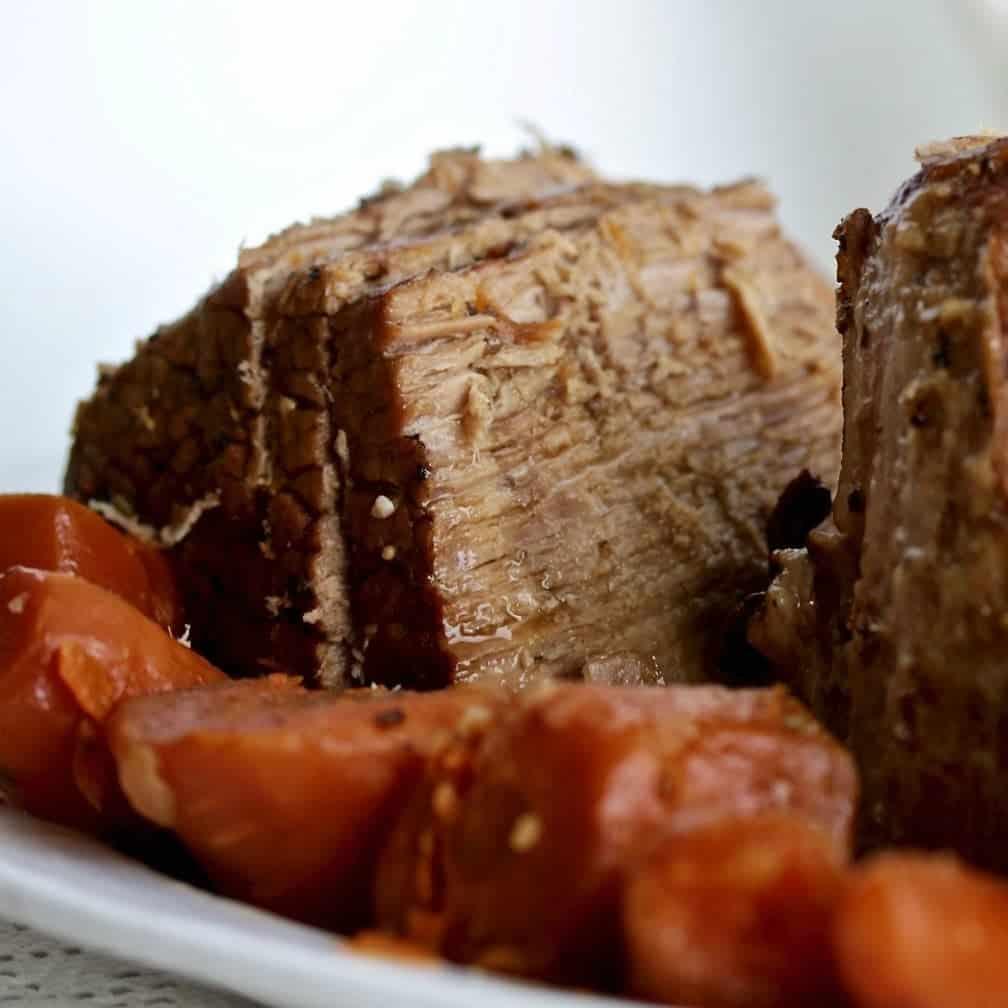 Instant Pot Roast Beef Sliced On A Platter With Vegetables