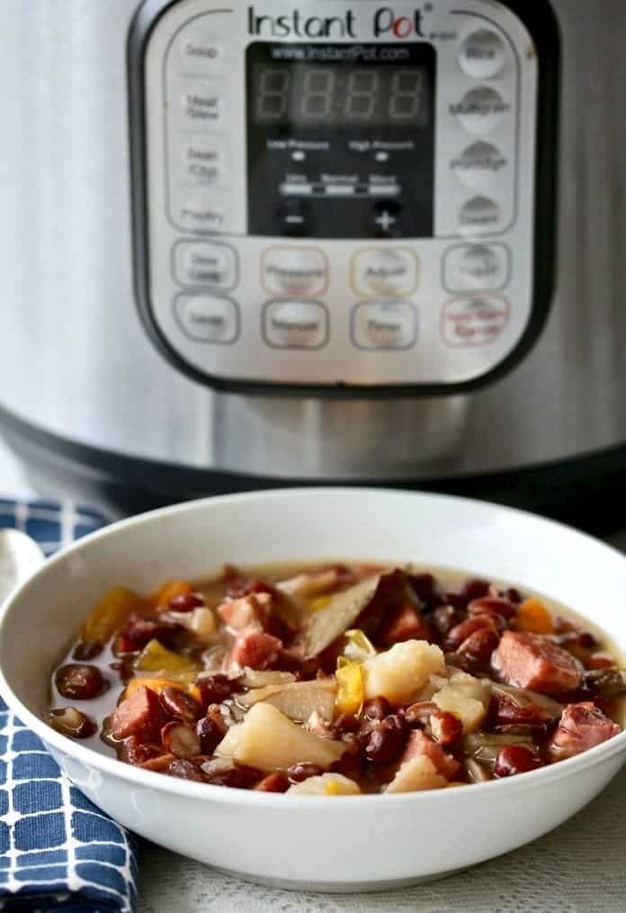 Instant Pot Hambone Bean Soup is easy to make and stretches a dollar tight! Your Family will love this richly flavored smoky soup. #dairyfree #glutenfree #hambone #hambonesoup #instantpotrecipe