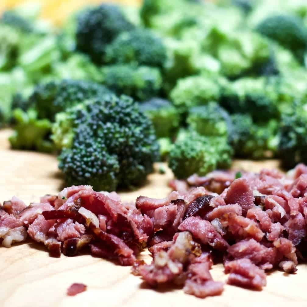 Cooked Chopped Bacon And Fresh Broccoli Ready To Cook.