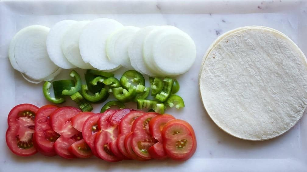Fresh Vegetables and white corn tortillas are perfect for chili verde